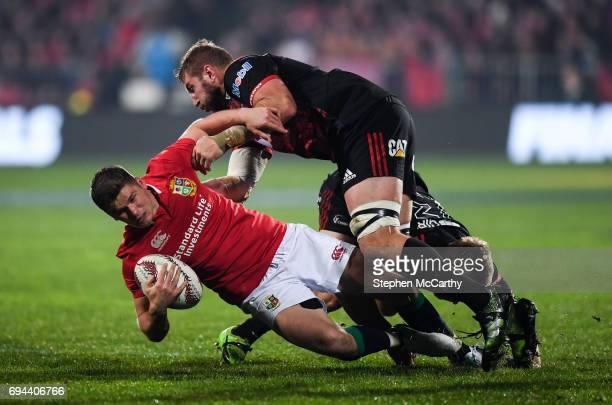 Christchurch New Zealand 10 June 2017 Owen Farrell of the British Irish Lions is tackled by Luke Romano right and Jack Goodhue of Crusaders during...