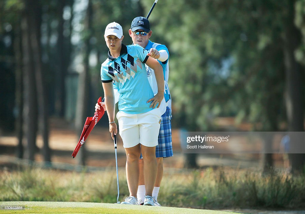 Christel Boeljon of The Netherlands lines up a putt with her caddie Andy Dearden on the seventh green during the second round of the 69th US Women's...