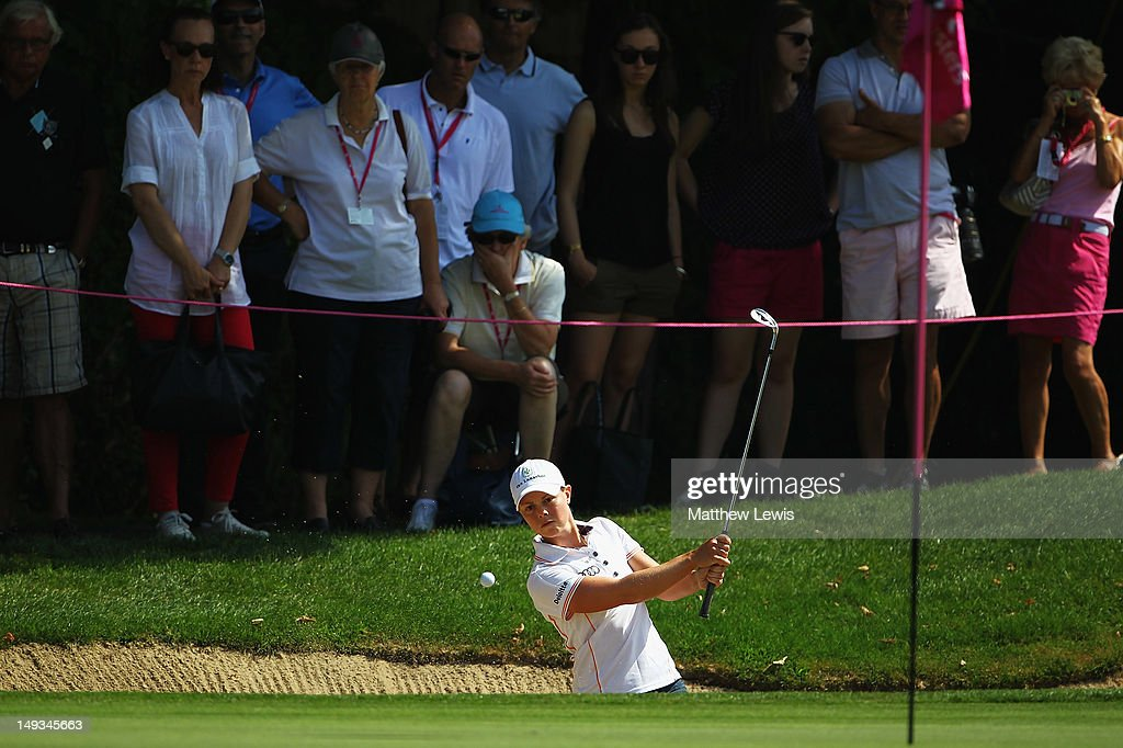 Christel Boeljon of the Netherlands plays out of the bunker on the 5th hole during day two of the Evian Masters at the Evian Masters Golf Club on...