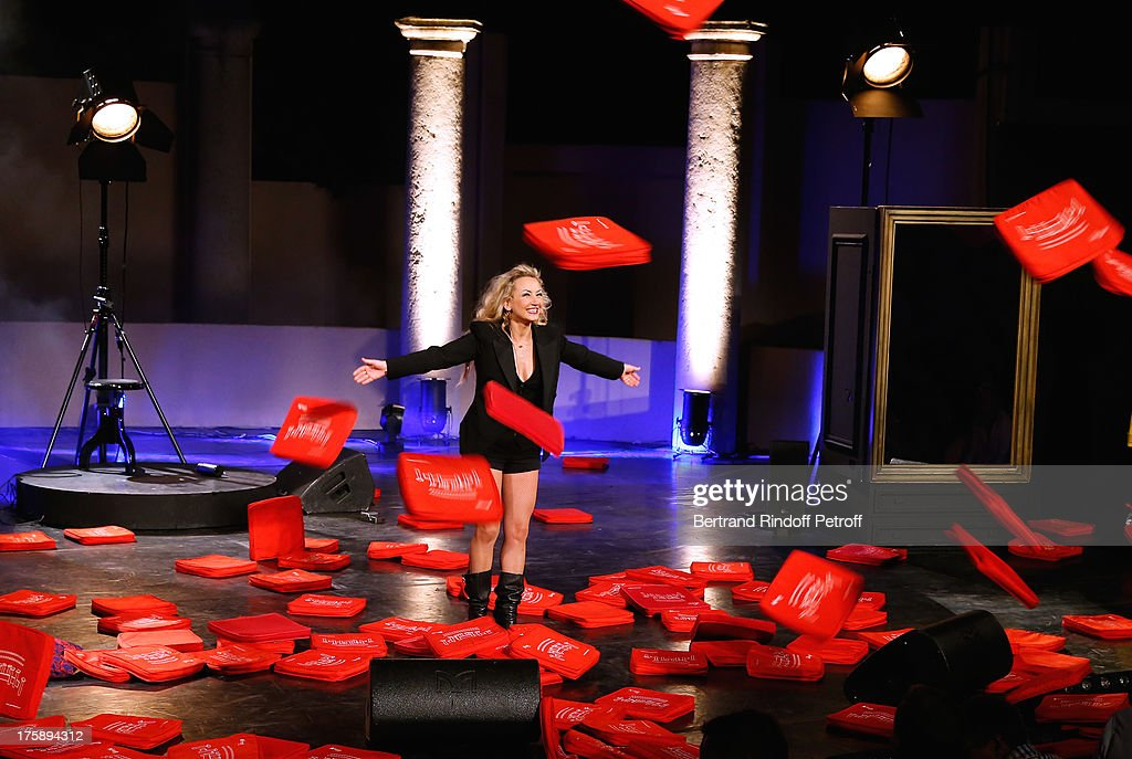 Christelle Chollet during the traditional throw of cushions at the final of her one woman show 'The New Show', written and set stage by Remy Caccia at 29th Ramatuelle Festival day 10 on August 9, 2013 in Ramatuelle, France.