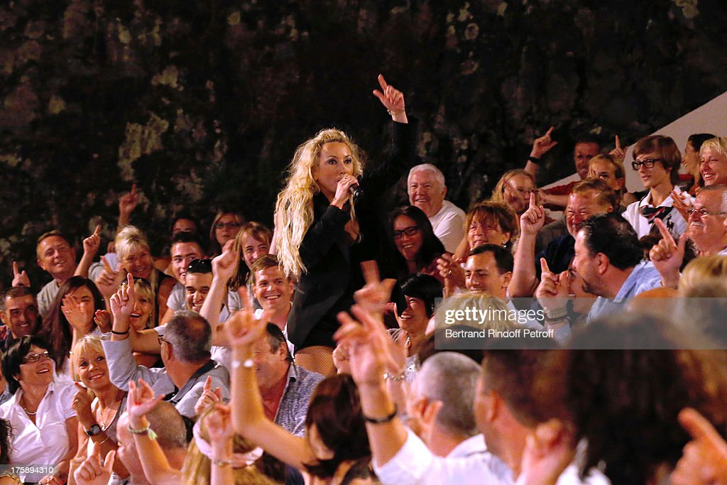 Christelle Chollet performs in her one woman show 'The New Show', written and set stage by Remy Caccia at 29th Ramatuelle Festival day 10 on August 9, 2013 in Ramatuelle, France.