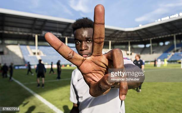 ChristEmmanuel Maouassa of France celebrates the victory during the U19 match between Portugal and France at CarlBenzStadium on July 21 2016 in...