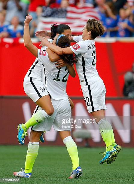 Christen Press celebrates with Lauren Holiday and Meghan Klingenberg of the United States after Press scores a second half goal against Australia...