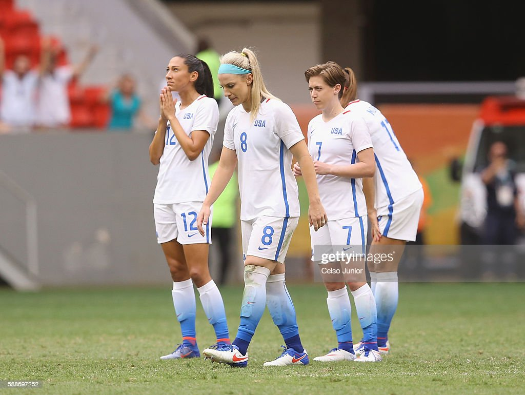 Christen Press #12, Julie Johnston #8, Meghan Klingenberg #7 and Tobin Heath #17 of United States react after their 1-1 (3-4 PSO) loss to Sweden during the Women's Football Quarterfinal match at Mane Garrincha Stadium on Day 7 of the Rio 2016 Olympic Games on August 12, 2016 in Brasilia, Brazil.