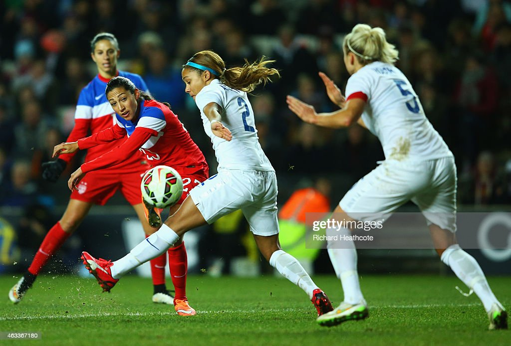 Christen Press of the United States shoots past Alex Scott and Steph Houghton of England during the Women's Friendly International match between...
