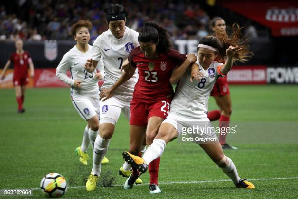 Christen Press of the USA fights for the ball with Sohyun Cho of the Korea Republic at the MercedesBenz Superdome on October 19 2017 in New Orleans...