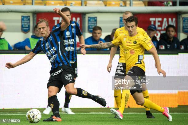 Christer Gustafsson of IK Sirius FK fight for the ball with Rasmus Rosenqvist of IF Elfsborg during the Allsvenskan match between IF Elfsborg and IK...