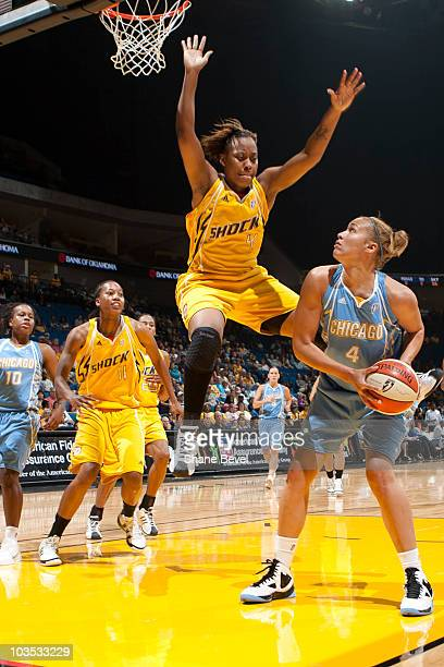 Christi Thomas of the Chicago Sky tries to get past Amber Holt of the Tulsa Shock during the WNBA game on August 21 2010 at the BOK Center in Tulsa...