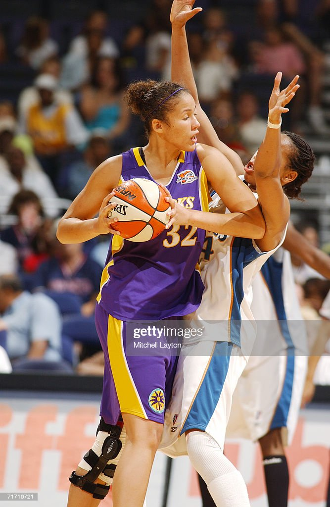 Christi Thomas #32 of the Los Angeles Sparks looks to move the ball against the Washington Mystics during the game on August 1, 2006 at MCI Center in Washington, D.C. The Mystics won 84-74.
