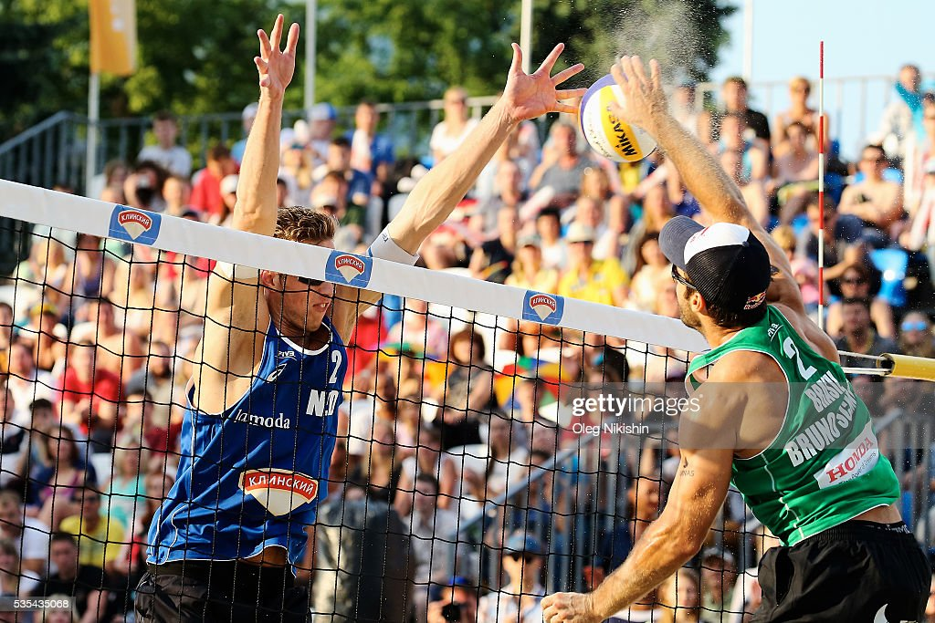 Christiaan Varenhorst of Netherlands blocks an attack of Bruno Oscar Schmidt of Brazil during a game between Netherlands and Brazil on day 6 of the FIVB Moscow Grand Slam at sports complex Dynamo Vodny Stadium on May 29, 2016 in Moscow, Russia.