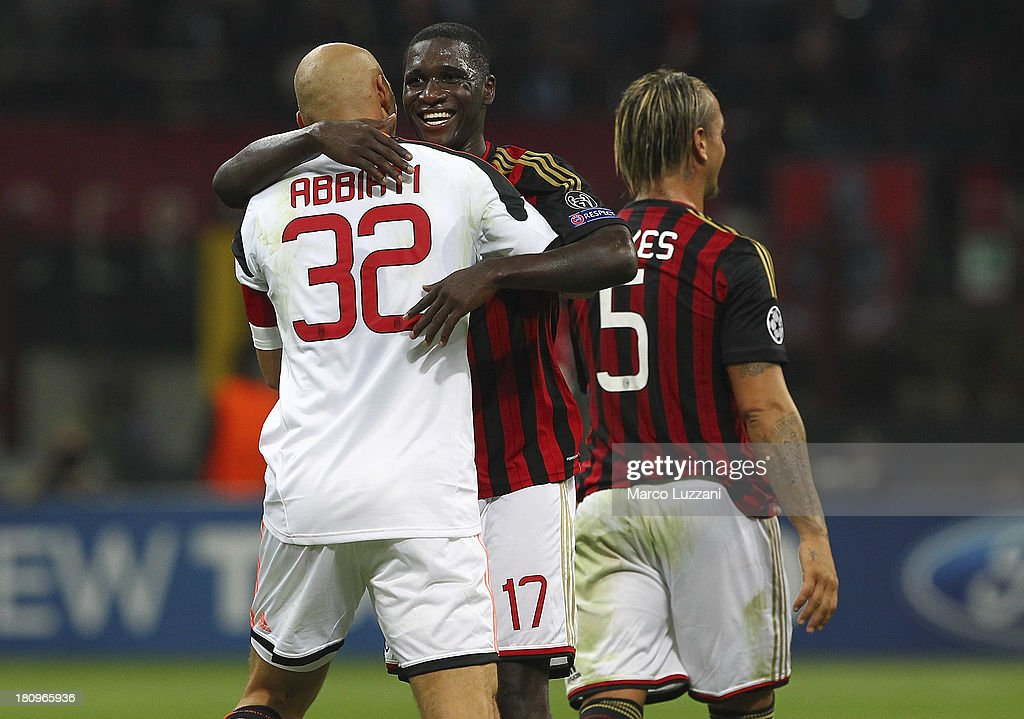 Christian Abbiati (L) and Cristian Zapata (R) of AC Milan celebrate victory at the end of the UEFA Champions League group H match between AC Milan and Celtic at Stadio Giuseppe Meazza on September 18, 2013 in Milan, Italy.