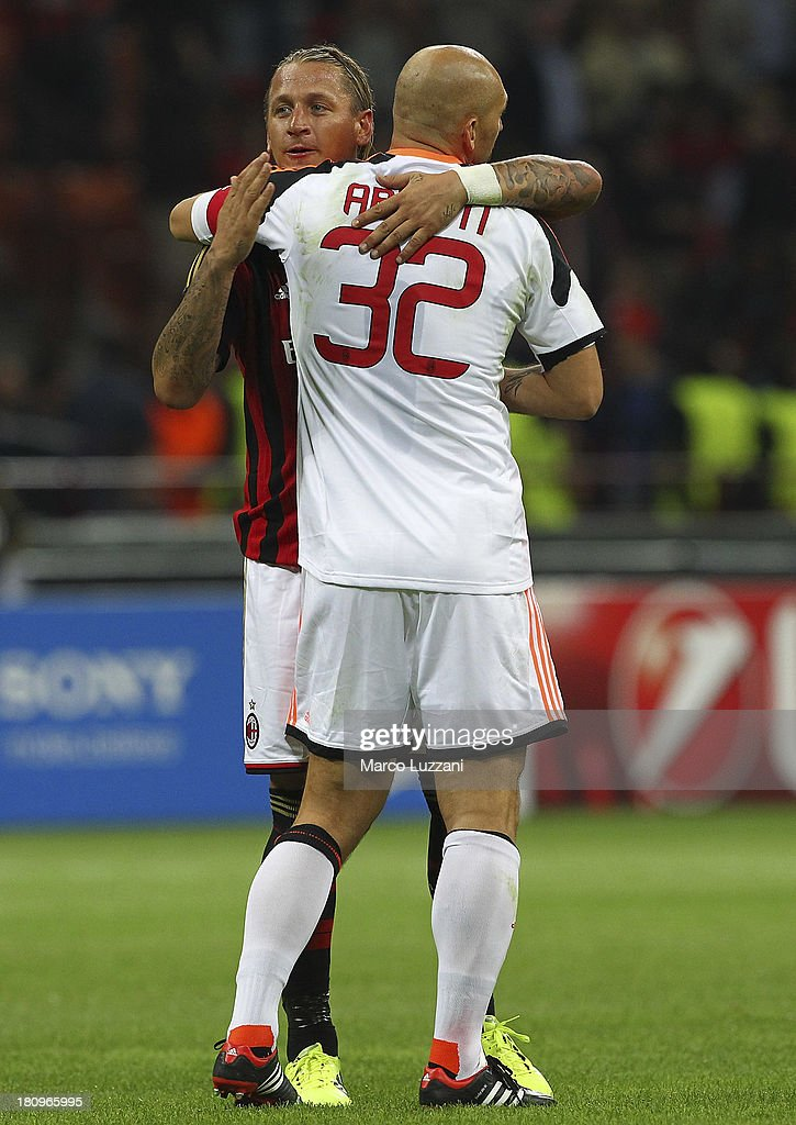 Christian Abbiati (L) and Philippe Mexes (R) of AC Milan celebrate victory at the end of the UEFA Champions League group H match between AC Milan and Celtic at Stadio Giuseppe Meazza on September 18, 2013 in Milan, Italy.