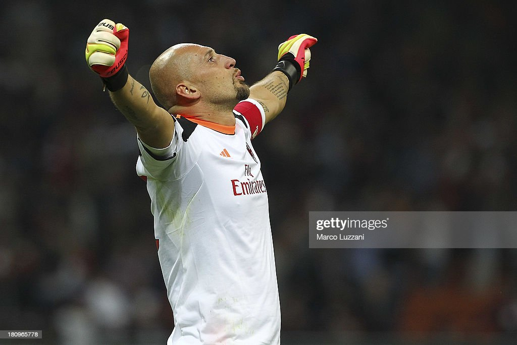 <a gi-track='captionPersonalityLinkClicked' href=/galleries/search?phrase=Christian+Abbiati&family=editorial&specificpeople=2158791 ng-click='$event.stopPropagation()'>Christian Abbiati</a> of AC Milan celebrates his team-mate Sulley Ali Muntari's goal during the UEFA Champions League group H match between AC Milan and Celtic at Stadio Giuseppe Meazza on September 18, 2013 in Milan, Italy.