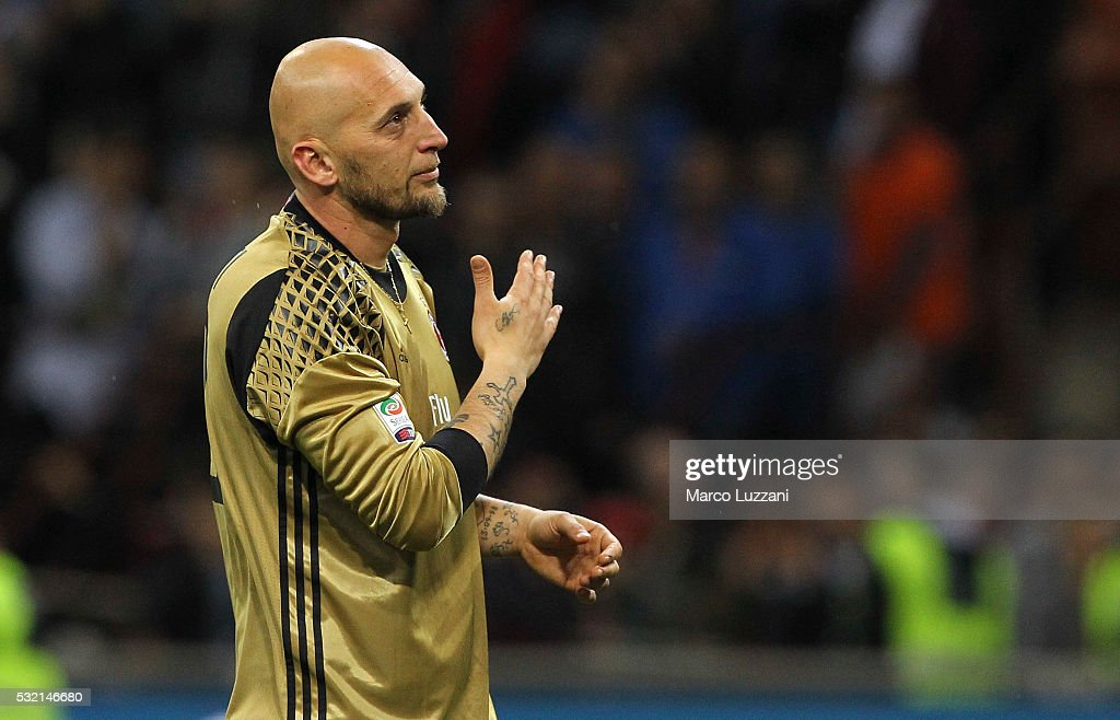 <a gi-track='captionPersonalityLinkClicked' href=/galleries/search?phrase=Christian+Abbiati&family=editorial&specificpeople=2158791 ng-click='$event.stopPropagation()'>Christian Abbiati</a> of AC Milan salutes the fans for his last game to his career at the end of the Serie A match between AC Milan and AS Roma at Stadio Giuseppe Meazza on May 14, 2016 in Milan, Italy.