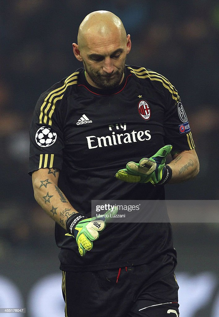 <a gi-track='captionPersonalityLinkClicked' href=/galleries/search?phrase=Christian+Abbiati&family=editorial&specificpeople=2158791 ng-click='$event.stopPropagation()'>Christian Abbiati</a> of AC Milan shows his dejection during the UEFA Champions League Group H match between AC Milan and Ajax Amsterdam at Stadio Giuseppe Meazza on December 11, 2013 in Milan, Italy.
