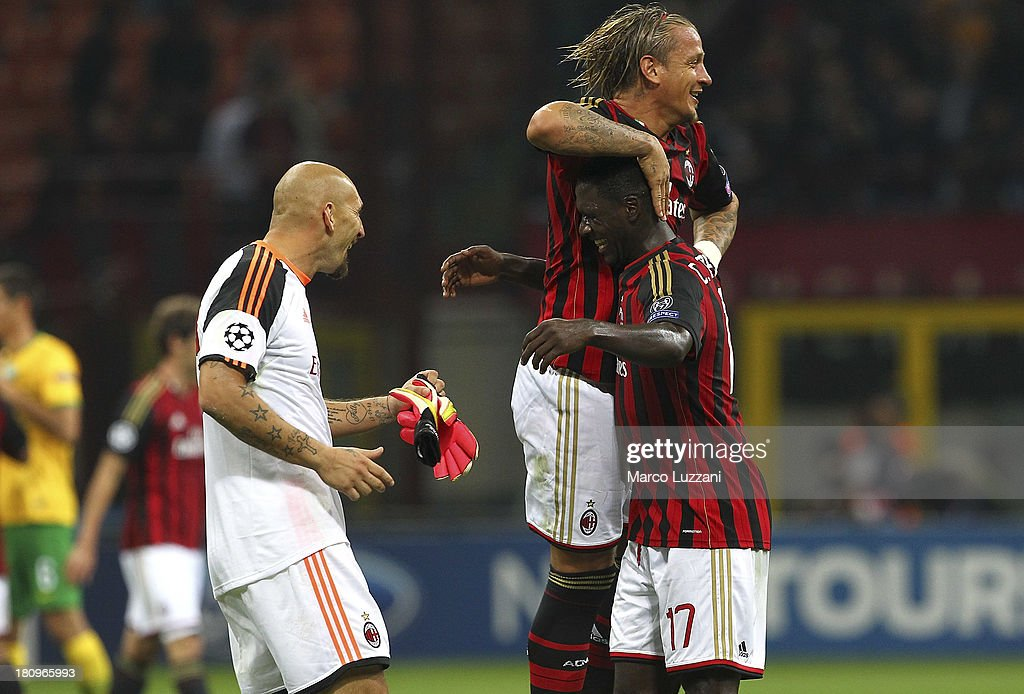Christian Abbiati (L), Philippe Mexes (C) and Cristian Zapata (R) of AC Milan celebrate victory at the end of the UEFA Champions League group H match between AC Milan and Celtic at Stadio Giuseppe Meazza on September 18, 2013 in Milan, Italy.