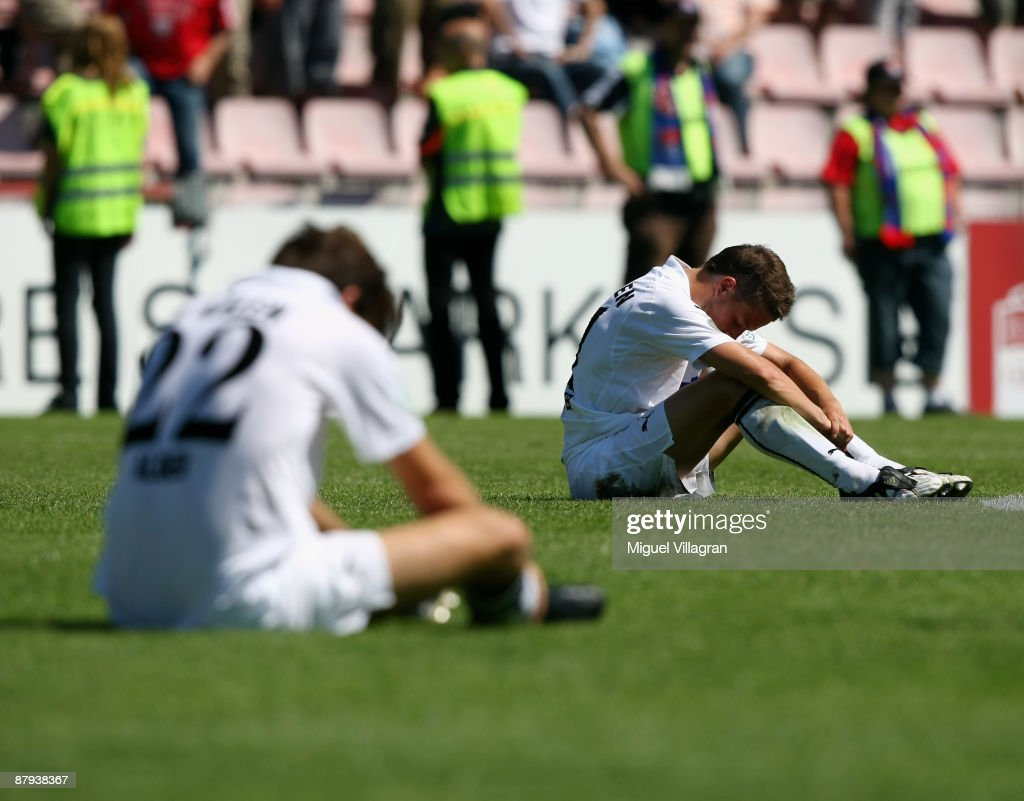 Christian Adler and Marcus Steegmann of Aalen look dejected after losing the 3 Liga match between SpVgg Unterhaching and VfR Aalen at the...