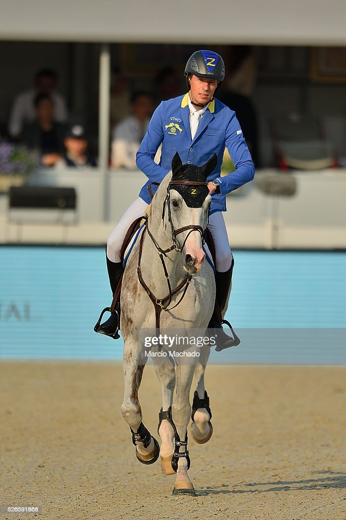 Christian Ahlamann of Germany hiding Cornado II during the Longines Global Champions Tour of Shanghai day 2 jump-off 1.60 m height on April 30, 2016 in Shanghai, China.