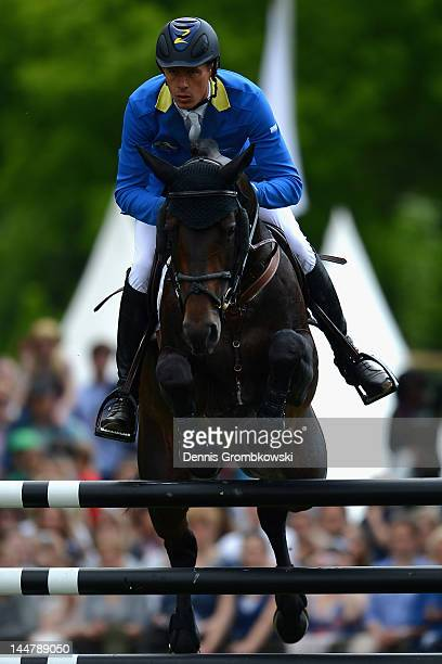 Christian Ahlmann of Germany and Codex One compete in the CSI5 Global Champions Tour Grand Prix of Hamburg during day three of the German Jumping...