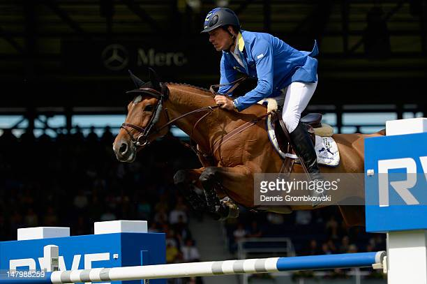 Christian Ahlmann of Germany and his horse Lorena 111 compete in the Prize of AachenMuenchener jumping competition during day five of the 2012 CHIO...