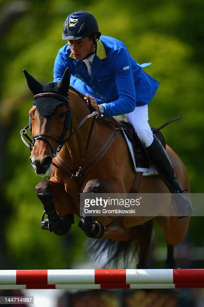 Christian Ahlmann of Germany and Lorena compete in the CSI5 jumping competition against the clock during day two of the German Jumping Dressage Grand...