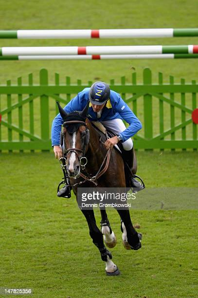 Christian Ahlmann of Germany and Taloubet compete in the Warsteiner Price of Europe S4 jumping competition during day two of the 2012 CHIO Aachen...