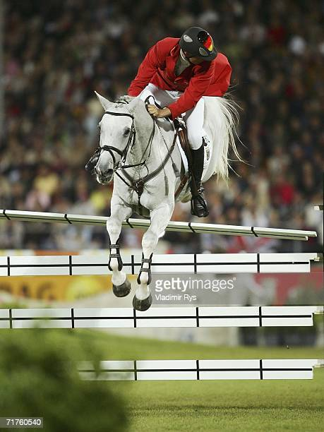 Christian Ahlmann of Germany in action on Coester misses on the last hurdle during the Jumping team final at the 2006 World Equestrian Games on...