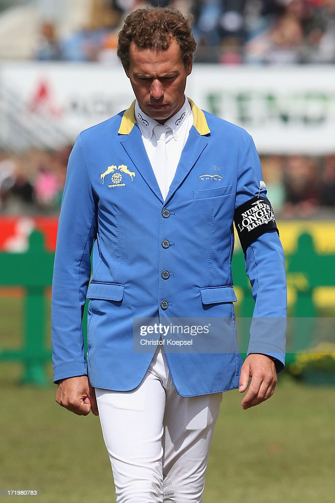 <a gi-track='captionPersonalityLinkClicked' href=/galleries/search?phrase=Christian+Ahlmann&family=editorial&specificpeople=224771 ng-click='$event.stopPropagation()'>Christian Ahlmann</a> of Germany looks dejected during the Rolex Grand Prix jumping competition during the 2013 CHIO Aachen tournament on June 30, 2013 in Aachen, Germany.