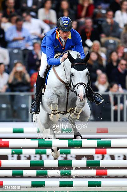 Christian Ahlmann of Germany on Cornado II in action during the Prix Hermes Sellier during the first day of the Grand Prix Hermes of Paris at Grand...