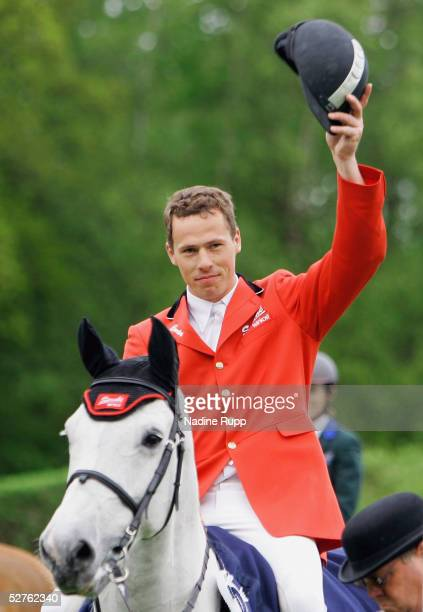Christian Ahlmann of Germany on his horse Coester celebrates winning the Volkswagen Championat of Hamburg at he German Jumping and Dressage Grand...