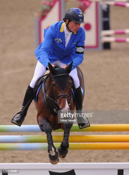 Christian Ahlmann of Germany on Little Lady Z on his way to victory in the afternoon competition during the Longines Global Champions Tour of London...