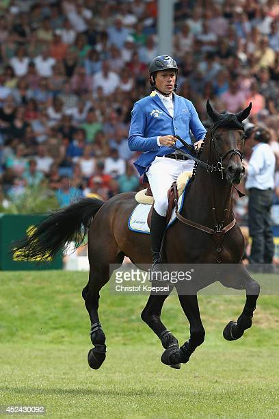 Christian Ahlmann of Germany rides on Codex One during the Rolex Grand Prix jumping competition during the 2014 CHIO Aachen tournament on July 20...