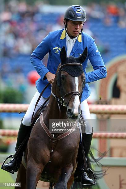 Christian Ahlmann of Germany rides on Taloubet during the Warsteiner Price jumping competition during day two of the 2013 CHIO Aachen tournament on...