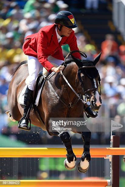Christian Ahlmann of Germany rides Taloubet Z during the Jumping Team Round 2 during Day 12 of the Rio 2016 Olympic Games at the Olympic Equestrian...