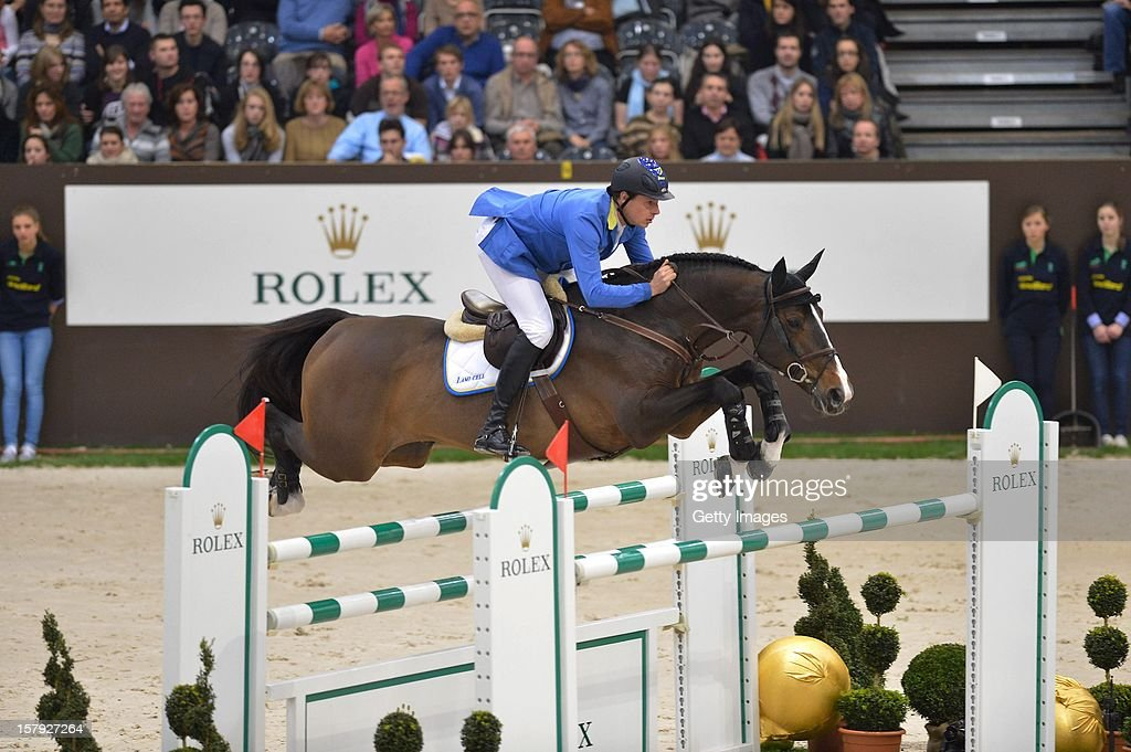 <a gi-track='captionPersonalityLinkClicked' href=/galleries/search?phrase=Christian+Ahlmann&family=editorial&specificpeople=224771 ng-click='$event.stopPropagation()'>Christian Ahlmann</a> of Germany rides Taloubet Z to victory in the Rolex IJRC Top Ten at Palexpo on December 7, 2012 in Geneva, Switzerland.