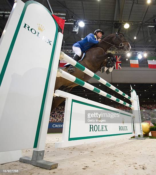 Christian Ahlmann of Germany rides Taloubet Z to victory in the Rolex IJRC Top Ten at Palexpo on December 7 2012 in Geneva Switzerland