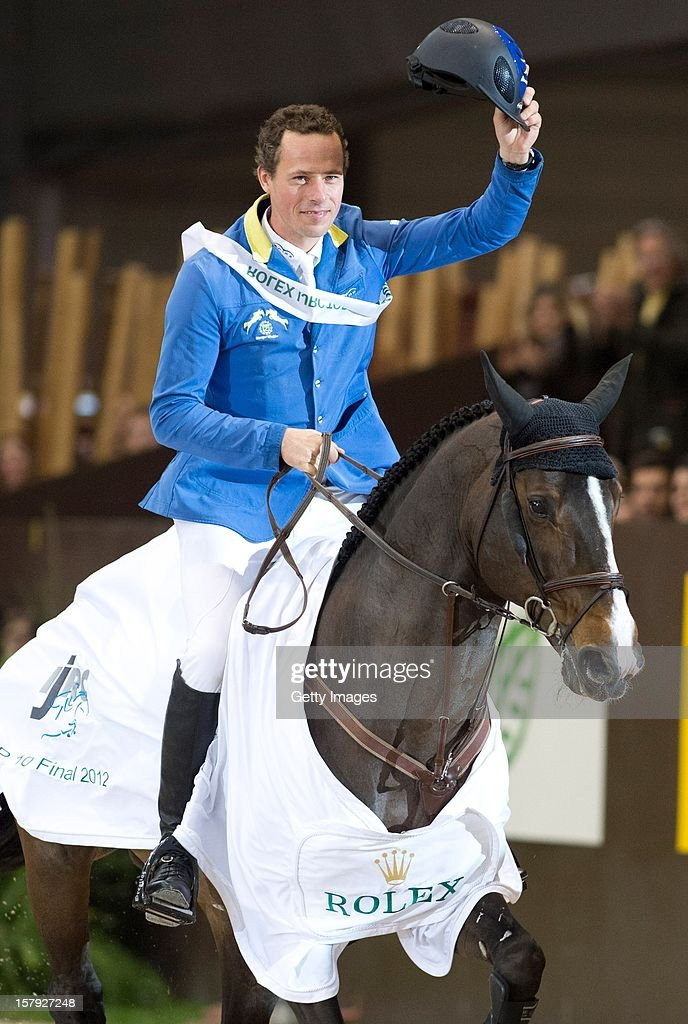 <a gi-track='captionPersonalityLinkClicked' href=/galleries/search?phrase=Christian+Ahlmann&family=editorial&specificpeople=224771 ng-click='$event.stopPropagation()'>Christian Ahlmann</a> of Germany riding Taloubet Z celebrates victory in the Rolex IJRC Top Ten at Palexpo on December 7, 2012 in Geneva, Switzerland.