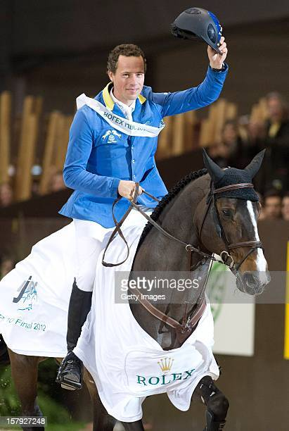 Christian Ahlmann of Germany riding Taloubet Z celebrates victory in the Rolex IJRC Top Ten at Palexpo on December 7 2012 in Geneva Switzerland