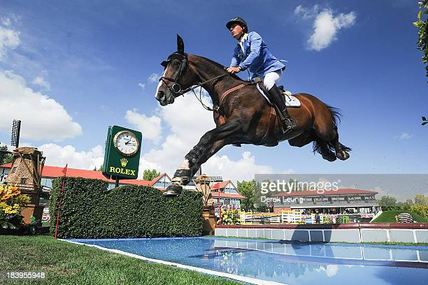 Christian Ahlmann of Germany riding Taloubet Z competes in the individual jumping equestrian on the final day of the Masters tournament at Spruce...
