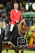 Christian Ahlmann riding Epleaser van T Heike during the ceremony for the German team after their victory in the Nations Cup on July 14 2016 in...
