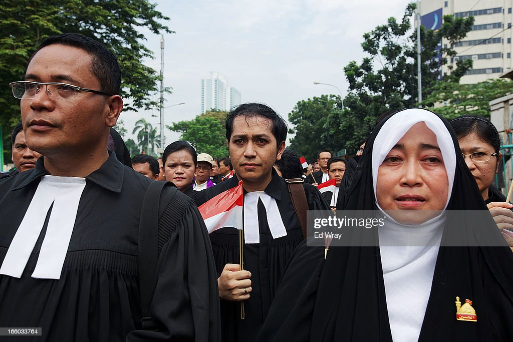 Christian and Muslim clergy march to the parliament to demonstrate for religious tolerance on the streets of Jakarta on April 8, 2013 in Jakarta, Indonesia. Recent reports suggest upwards of 260 violent attacks against religious minorities occured in 2012 in Indonesia.