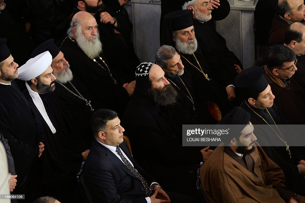 Christian and Muslim clerics attend the funeral of Greek Orthodox patriarch of Syria, Ignatius IV Hazim, at the Meriamiah Church in the Syrian capital Damascus on December 10, 2012. The patriarch died of a stroke in the Lebanese capital Beirut on December 5. AFP PHOTO/ LOUAI BESHARA