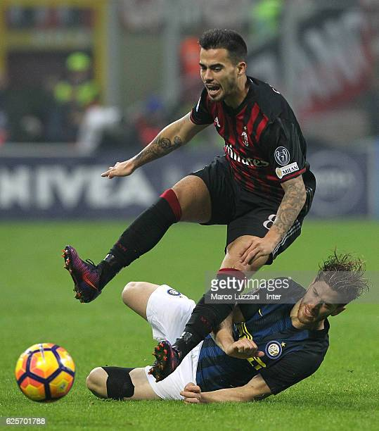 Christian Ansaldi of FC Internazionale Milano competes for the ball with Suso of AC Milan during the Serie A match between AC Milan and FC...