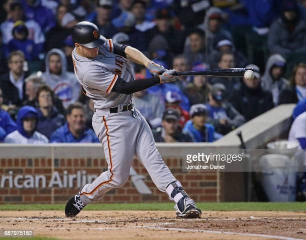 Christian Arroyo of the San Francisco Giants drives in a run on a fielder's choice in the 2nd inning against the Chicago Cubs at Wrigley Field on May...