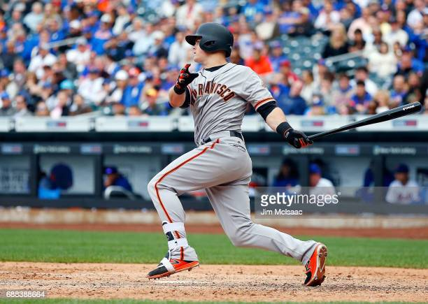 Christian Arroyo of the San Francisco Giants follows through on a ninth inning RBI hit against the New York Mets at Citi Field on May 10 2017 in the...
