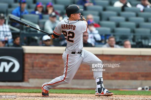 Christian Arroyo of the San Francisco Giants hits a three run double in the ninth inning against the New York Mets at Citi Field on May 10 2017 in...