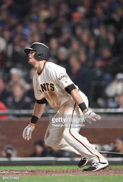 Christian Arroyo of the San Francisco Giants hits a tworun homer against the Los Angeles Dodgers in the bottom of the seventh inning at ATT Park on...