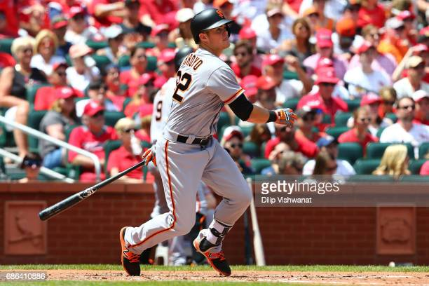 Christian Arroyo of the San Francisco Giants hits an RBI double against the St Louis Cardinals in the third inning at Busch Stadium on May 21 2017 in...