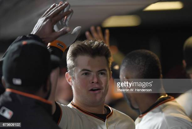 Christian Arroyo of the San Francisco Giants is congratulated by teammates after he hit a tworun homer against the Los Angeles Dodgers in the bottom...
