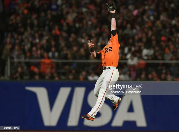 Christian Arroyo of the San Francisco Giants leaps to rob a hit from Ender Inciarte of the Atlanta Braves in the top of the seventh inning at ATT...